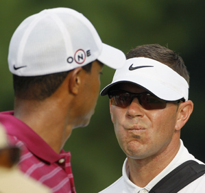 Instructor Sean Foley, right, looked at Tiger Woods's swing during his practice round Tuesday.
