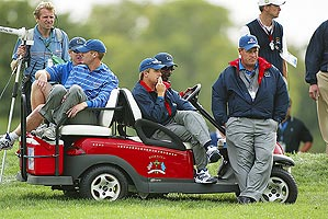 """Captain Sutton (right) """"worked"""" the course at Oakland Hills in '04."""