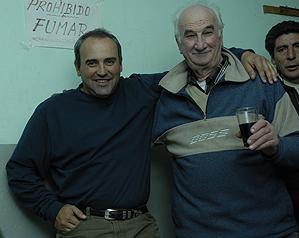 Cabrera (left) revels in Fridays with his backroom <i>companeros</i> at Almacen y Bar Condor in Villa Allende.