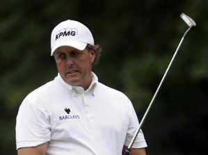 Phil Mickelson bogeyed three par 5s on his way to a 76.
