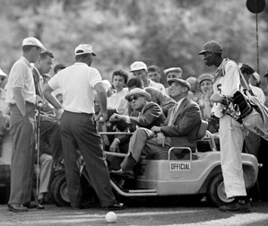 Ken Venturi, left, and Arnold Palmer spoke with rules officials at the 12th hole during the 1958 Masters.