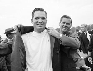 Gay Brewer, right, helps Bob Goalby into the green jacket as champion of the Masters in 1968. Brewer, the 1967 Masters champion who won 11 times on the PGA Tour, died Friday at 75.