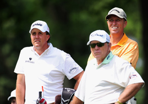 Phil Mickelson was joined by coach Butch Harmon and caddie Jim 'Bones' MacKay during a practice round on Wednesday.