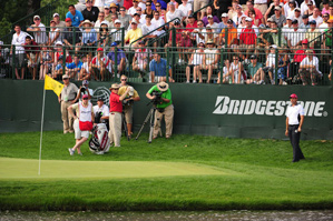 Padraig Harrington made a triple bogey on the 16th hole after being warned for slow play.