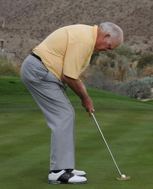 Move your chest closer to the ball to make your stance and stroke impervious to wind.