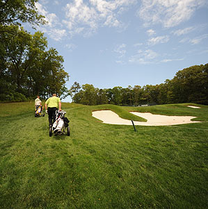 Hills, hand carts and huge bunkers define a day on the Black course at Bethpage.