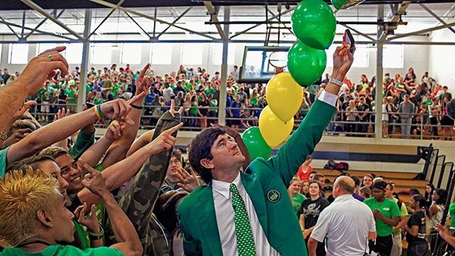 Bubba Watson snaps a selfie in the packed Milton High School gymnasium in Bagdad, Fla.
