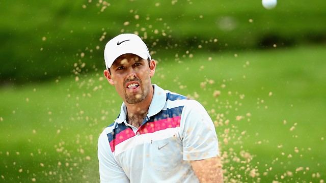 Charl Schwartzel fired a 65 to tie Marco Crespi for the lead.