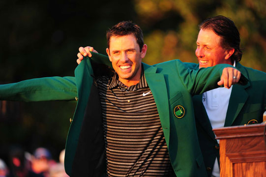 Defending champion, Phil Mickelson, presents Schwartzel with his first green jacket.
