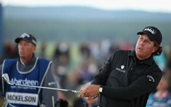 Phil Mickelson, with caddie Bones Mackay, Sunday at the Scottish Open, Mickelson's first-ever win the UK.