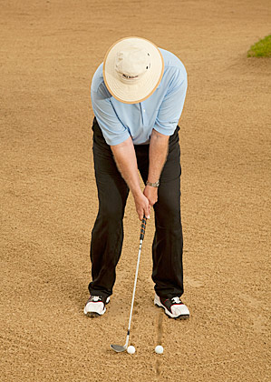 Trying to hit an imaginary ball positioned four to five inches behind the real one helps you create the perfect divot.