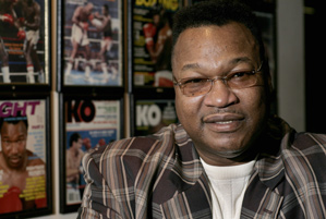 Larry Holmes, shown here in 2007, and Tiger Woods shared the same trainer, Keith Kleven.