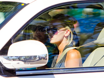 Paulina Gretzky, right, and Dustin Johnson drive away after Johnson withdrew from the Sony Open.