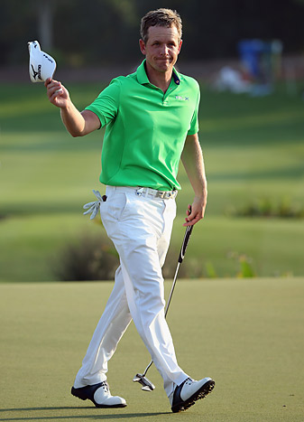 Luke Donald shot a 65 to take the first-round lead.