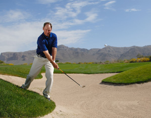 Set up with your right foot back and shoulders tilted to match the slope.