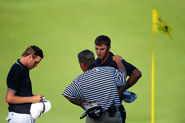 Dustin Johnson thought he was heading into a playoff with Bubba Watson and Martin Kaymer until a rules official told him there was a question about his second shot.