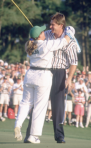Nick Faldo (with caddie Fanny Sunesson) won his final major championship at the 1996 Masters. It was his third green jacket.