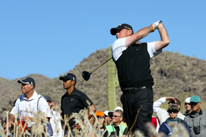 After beating Tiger Woods on Wednesday, Thomas Bjorn faces Geoff Ogilvy in the second round.