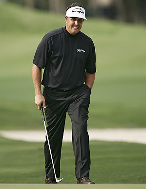 Phil Mickelson in a Callaway X-series mock turtleneck and flat-front performance pants.