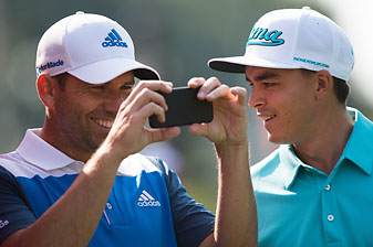 Rickie Fowler and Sergio Garcia share a light moment at the HSBC Champions pro-am Wednesday in Shanghai.