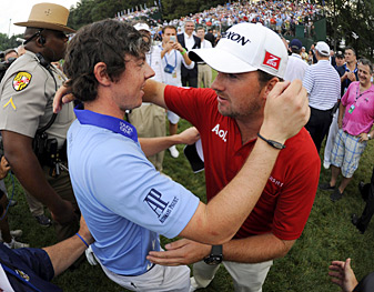 McDowell (right) was waiting by the 18th green at Congressional to offer congratulations after McIlroy kept the Open trophy in Northern Ireland in a record romp.