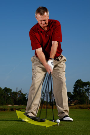 Waggle your driver back and forth a few times to loosen up your wrists and firm up your grip.