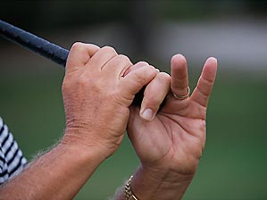 The clubhead should pass your hands early.