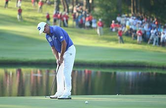 Scott Hend putts on the 18th green Sunday during the final round of the 2014 Hong Kong Open.