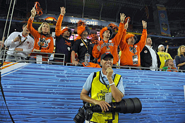 """Jim """"Bones"""" Mackay worked as an SI photo assistant Monday at the BCS title game."""