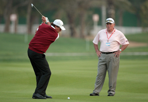 Phil Mickelson, left, got some work in Wednesday with swing coach Butch Harmon.