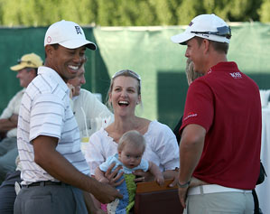Tiger Woods shared a laugh Tuesday with Henrik Stenson, right, his wife, and their daughter.