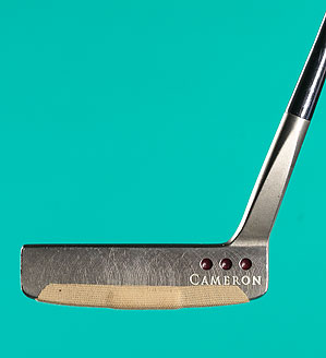 Putt with a Band-Aid attached to the bottom third of the putterface to strike the ball in the spot that gives you the purest roll.