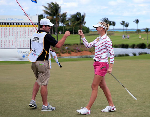 Jessica Korda fist-bumps caddie Kyle Bradley after putting out on the 18th hole during round two of the Pure Silk Bahamas LPGA Classic.