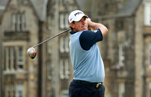 Lee Westwood is in contention despite a leg injury.