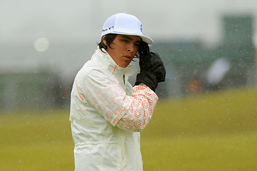 Rickie Fowler was sporting heavy gloves between shots and a white rain suit that set him apart from the crowd. He handled the weather as well as anyone on Saturday.