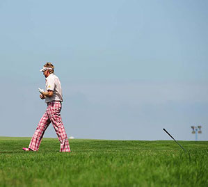 Poulter stepped away with the club shaking in the grass.