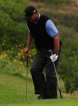 Playing for the first time in two months, Woods frequently showed signs that his left knee wasn't fully healed.