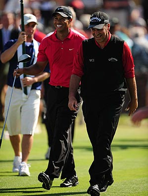 Tiger Woods and Rocco Mediate on Monday, both in red.