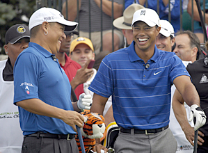 Tiger Woods, right, and Notah Begay at Begay's charity event in 2009.