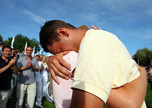Martin Kaymer hugged his girlfriend Jenny as he bursts into tears after winning The BMW International Open Golf Sunday.