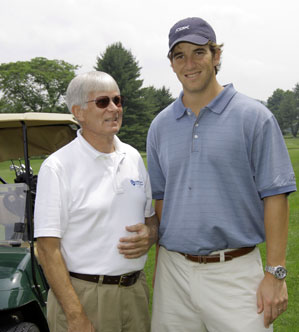 Eli Manning, host of the 31st Annual Guiding Eyes for the Blind Golf Classic, with blind golfer Phil Blackwell. Each year the blind golfers compete for the Corcoran Cup awarded to the blind golfer and coach with the best score.