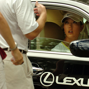Michelle Wie speaks to officials as she sits in a car waiting to leave Saturday.