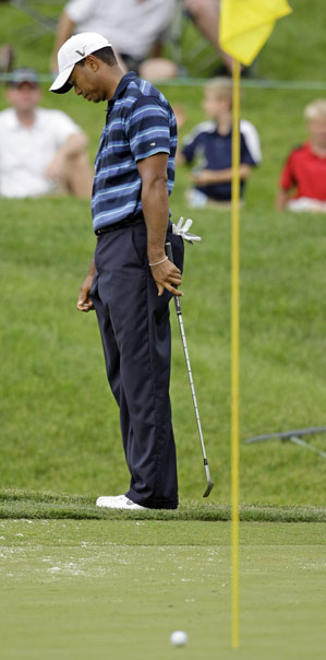 Tiger Woods made two birdies and two bogeys in easy conditions Thursday at the Memorial.