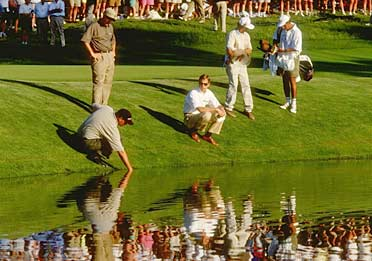 GONE FISHING: After Lehman's                 errant shot at 17                 rolled into the                 pond, he could                 reach the ball                 with his hand, but                 he couldn't play it.