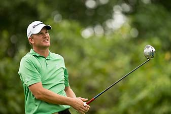 Robert Karlsson was 15 under overall with 11 holes left when rain suspended play Saturday at the OHL Classic in Mayakoba, Mexico.