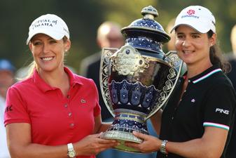 Cristie Kerr, left, received the trophy from tournament host Lorena Ochoa.