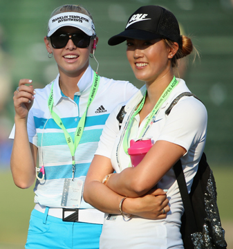 Jessica Korda and Michelle Wie watch the play during the final round of the 114th U.S. Open at Pinehurst No. 2.