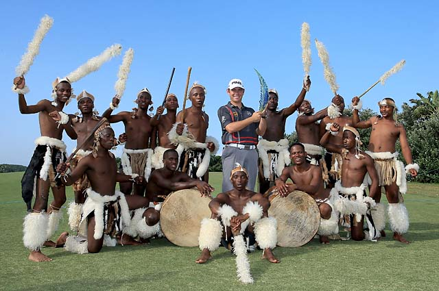 Louis Oosthuizen celebrates his win with local dancers after his victory during the final round of the 2014 Volvo Champions in Durban, South Africa.