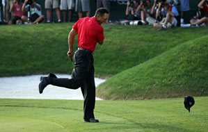 Tiger Woods was so focused that he forgot he had spiked his cap after sinking the decisive 24-foot birdie putt.