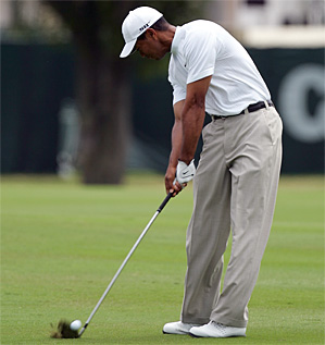Tiger Woods hitting his second shot Saturday at the par-5 first hole, where he made eagle.